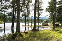 Canada, BC, Salmon Arm. Skimikin Lake. VW camper at partially flooded campsite beside lake.