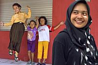 young woman and children, Sondakan district, Solo (Surakarta), Java island, Indonesia, Southeast Asia.