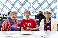 Seattle, Washington: Gertrude, Betty and Joan (l to r), retirees from Horizon House and volunteers with the League of Women Voters, spent the day regi...