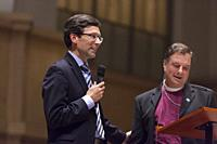 Seattle, Washington: Attorney General Bob Ferguson (l) and The Right Rev. Greg Rickel speak at St. Mark's Episcopal Cathedral during a discussion on t...