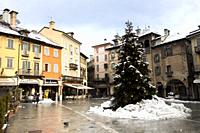 Christmas decorations at the Market Square after the snowstorm. Domodossola, Piedmont. Italy.