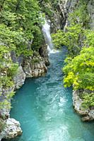 A turquoise pool below a waterfall on The Valbona River, part of the Valbona National Park, in North eastern Albania,.