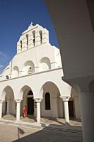 Visitor in front of the Greek Orthodox Cathedral in the old town Chora, Naxos Island, Cyclades Islands, Greek Islands, Greece, Europe