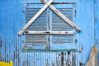 Wooden blueshutters. Loutro, Crete, Greece.