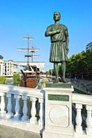 Galleon ship restaurant and bar on Vardar River and General Pakmenion statue, Skopje, Macedonia.