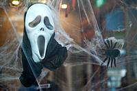 Singapore, Republic of Singapore, Asia - A Scream mask and a fake spider are used for Halloween decoration in a shop window.