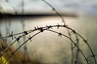 Barbed wire, Pointe du Hoc, Normandy. Pointe du Hoc is a promontory with a 100 ft (30 m) cliff overlooking the English Channel on the coast of Normand...