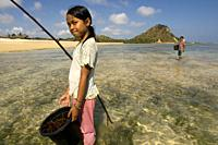 The women and their daughters usually go along the shore of the beach of Kuta, a fishing village south of Lombok, in search of highly prized seaweed f...