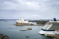 Sydney Harbour with iconic Sydney Opera House in view and large cruise liner docked at the Overseas Passenger Terminal, Circular Quay, Sydney, New Sou...