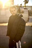 portrait of man with winter jacket, outdoors, blogger Adem Bayalan