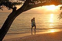 Sunbather at sunset, Barú Peninsula, Caribbean Sea, Colombia