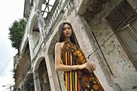 young Indonesian girl posing with a batik dress in the Kepodang Street, Old Town of Semarang, Java island, Indonesia, Southeast Asia.