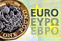 British £1 coin on a 5 Euro note.