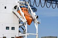Rotterdam, Netherlands - April 17, 2018: An Unsinkable, totally enclosed, free-fall lifeboat made of plastic, on angled launch platform at the rear of...