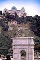 Italy, Marche, Ancona, Arco di Traiano, Arch of Trajan background Colle Guasco and Basilica Metropolitana di San Ciriaco Cathedral.