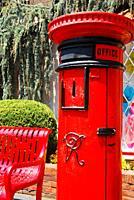 An authentic British pillar box at a public park.