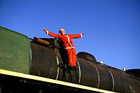 Man disguised as Santa Claus in a steam train locomotive