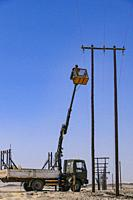 Arandis, Namibia Power lines getting erected in the desert.