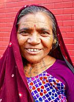 portrait of older woman in Rishikesh, India.