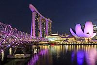 Cityscape at dusk with Marina Bay Sands, Modern Art Museum and Helix Bridge.