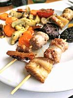 Skewers of sausages and meat.