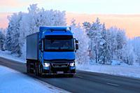 Salo, Finland - January 19, 2018: Blue Renault Trucks T semi of Transport Sjoman Oy Ab pulls trailer on rural highway through winter scenery at dusk.