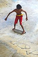 Young boys skateboarding in Midigama, Sri Lanka.