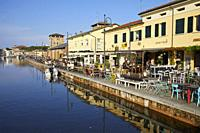 Buildings along the Canal of Cervia, Italy.