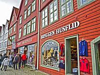 Shops and shoppers on the Hanseatic Wharf in the Bryggen section of Bergen, Norway.