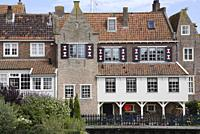 Enkhuizen, small city of northern holland, historic buildings with many windows and flowers.