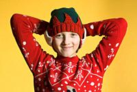 Portrait of a Boy with Blond Hair in Red Christmas Sweater.