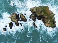 Islands in Costa Quebrada, Liencres, Cantabria, Spain.