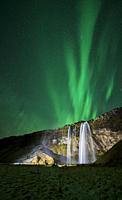 Seljalandsfoss Waterfall and Aurora Borealis, Iceland.