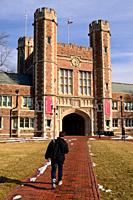 A student heads to Brookings Hall at Washington University in St Louis.
