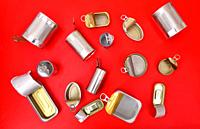top view of tin can isolated on red.