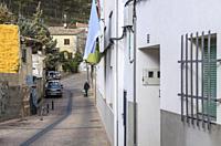 Street scene with pedestrian in background, San Antón quarter, Cuenca, Castile-La Mancha, Spain.