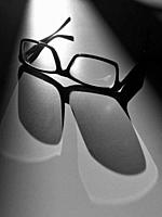 Glasses in the Light and Shadows. . .