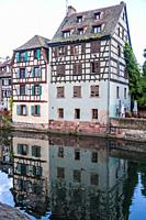 Canalside houses in the Petite France quarter of Strasbourg, Alsace, France.