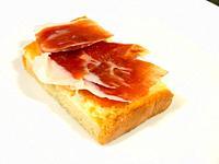 Iberian ham with tomato on toast. Spain.