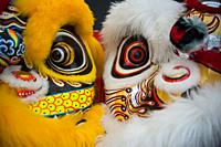Singapore, Republic of Singapore, Asia - Masks of costume outfits for a traditional lion dance performance are seen in front of a stage in Chinatown.