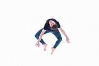Casual dressed contemporary dancer on white background.