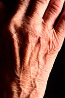detail of the hand of an older woman.