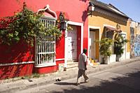 Local person in front of the colonial buildings at the historic center, Cartagena de Indias, Bolivar, Colombia, South America