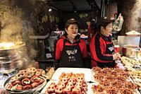 Chengdu, China - December 10, 2018: Chinese people selling street food in Chengdu Kuanzhai alley.