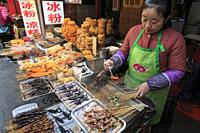 Chengdu, China - December 12, 2018: Insects and scorpions sold in a street market in Chengdu.