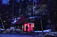 Stockholm, Sweden. Commuters at a bus stop on the island of Lidingö.