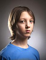 Portrait of a Boy with Blond Hair in Blue Top.