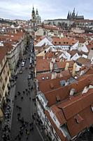 View of St Nicholas Church, Prague Castle and St Vitus Cathedral from Lesser Town Bridge Tower, Charles Bridge, Prague, Czech Republic.