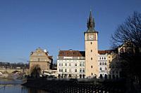 Clock tower, Vltava River, Prague, Czech Republic.