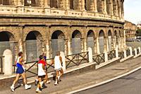 Jogging next to Colosseum, Coliseum, Flavian Amphitheatre, Rome, Lazio, Italy, Europe.